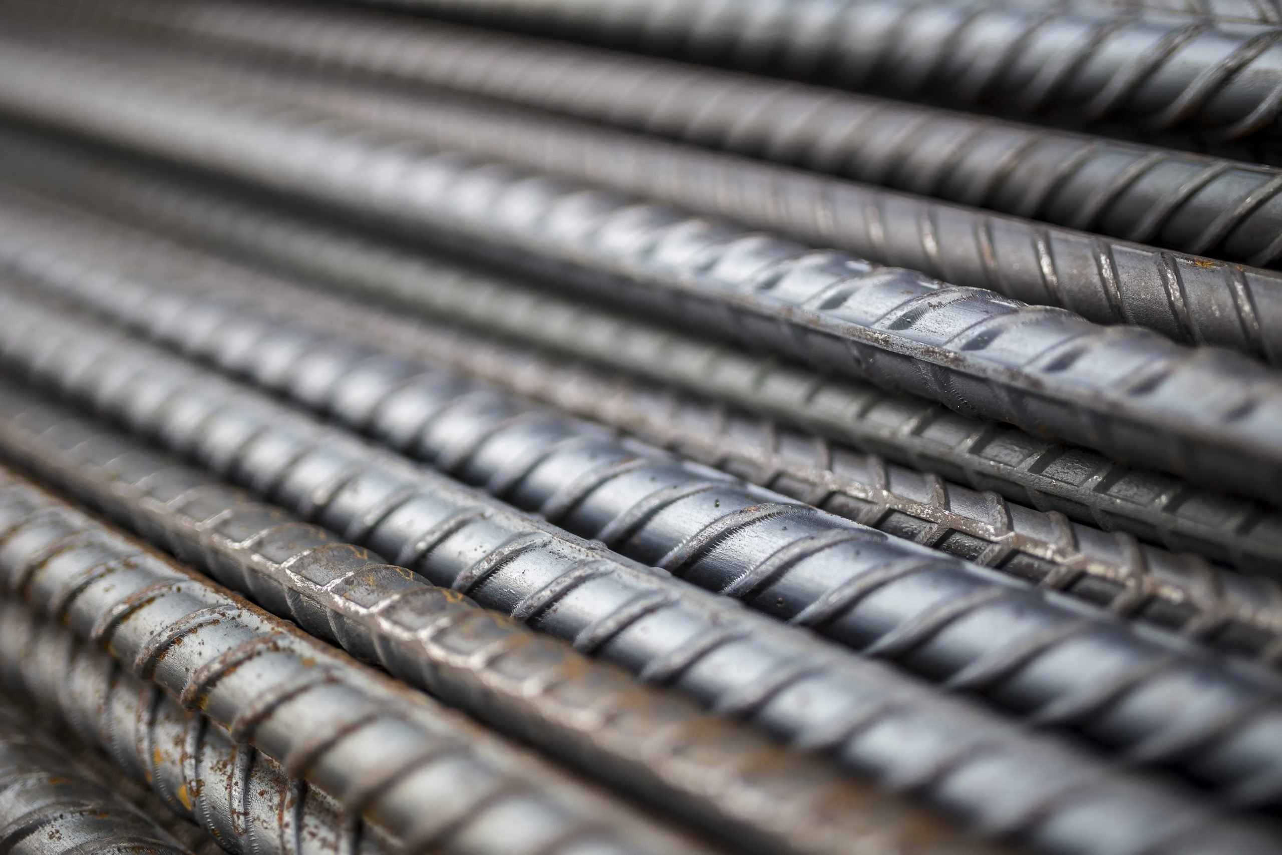 Stack of steel bar texture in construction site for background.